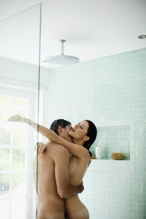 Affectionate couple in shower --- Image by © Felix Wirth/Corbis